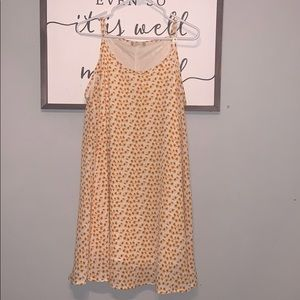 Yellow and Orange floral float dress. Never worn.